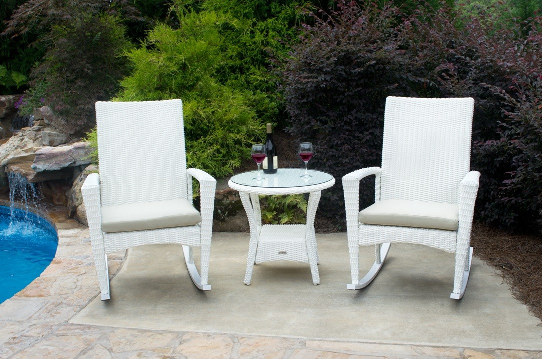 All weather patio set containing 2 rocking chairs and a table The Rocking